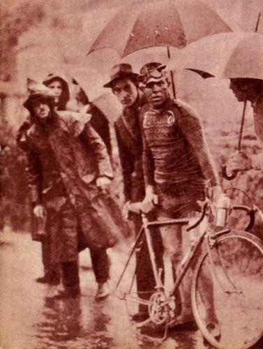 Milan - San Remo, 1936. Sheltered beneath a spectator's umbrella, Learco Guerra.jpeg